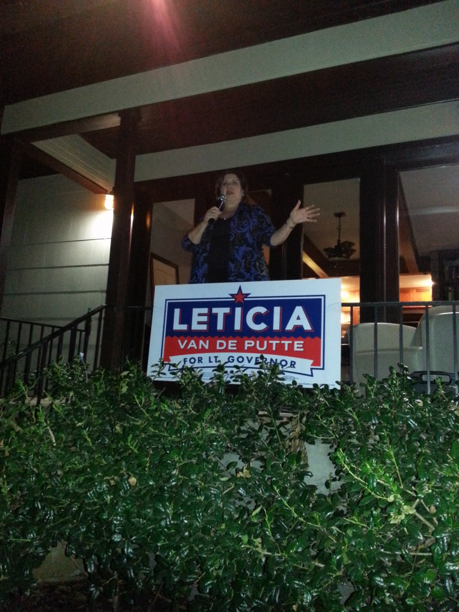 Leticia Van de Putte addresses a diverse crowd in Ramon Romero's back yard.