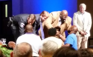 Police Chief Will Johnson, Mayor Jeff Williams and Pastor Dwight McKissic greet the family of Christian Taylor.